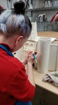 Vika working on door details